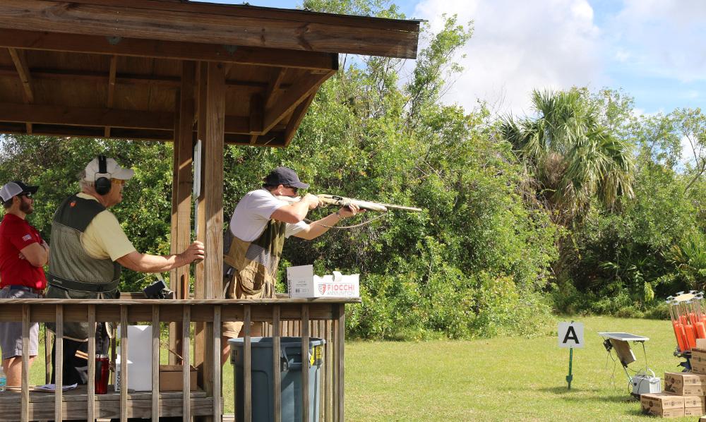 Person shooting a clay bird