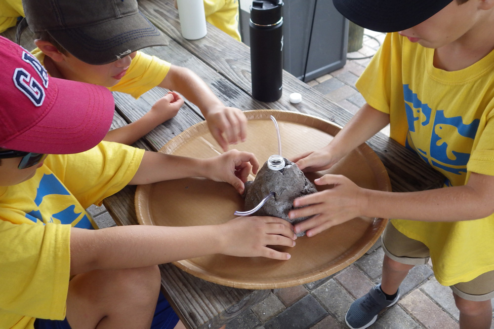 Summer campers doing a science experiment