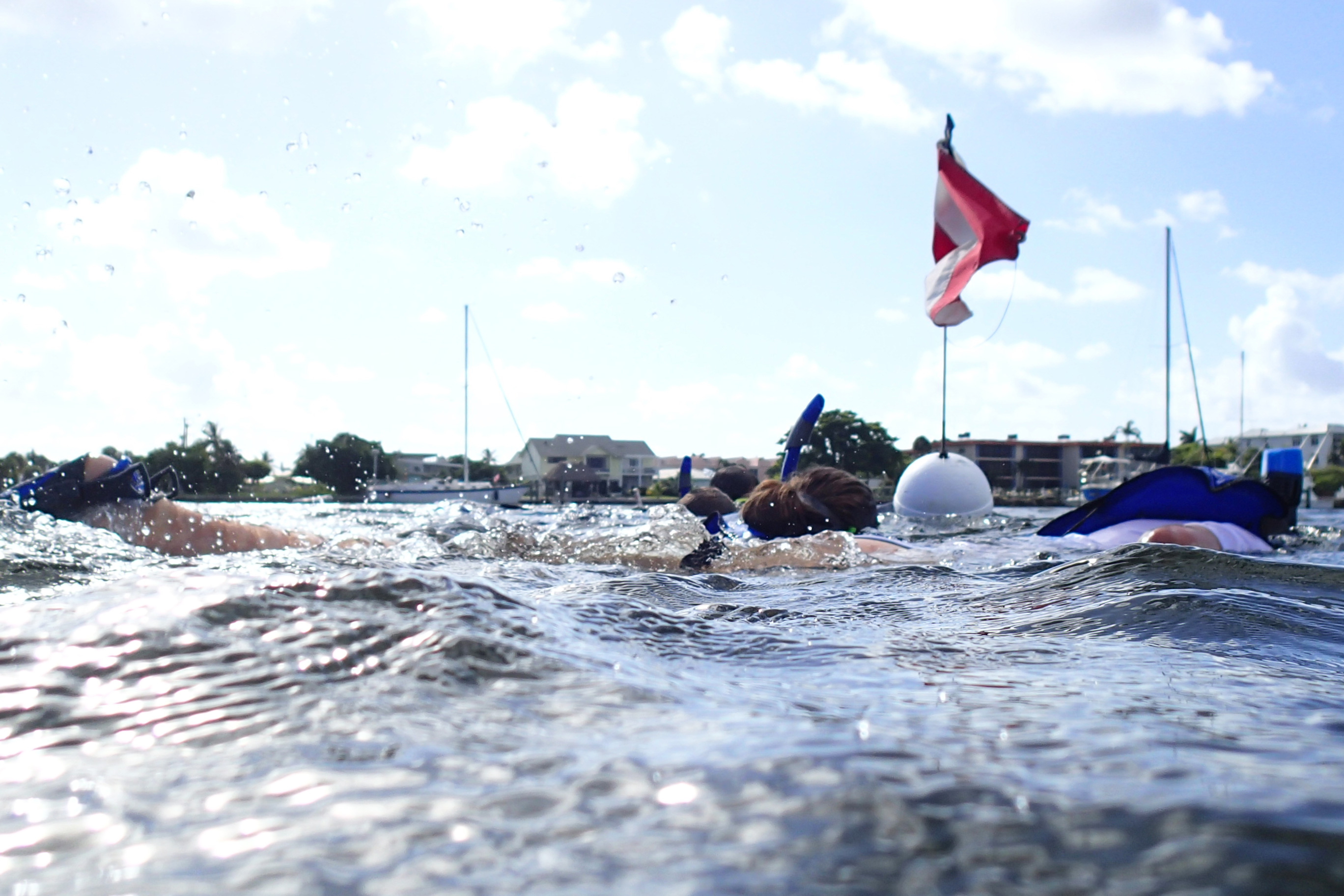 summer campers snorkeling