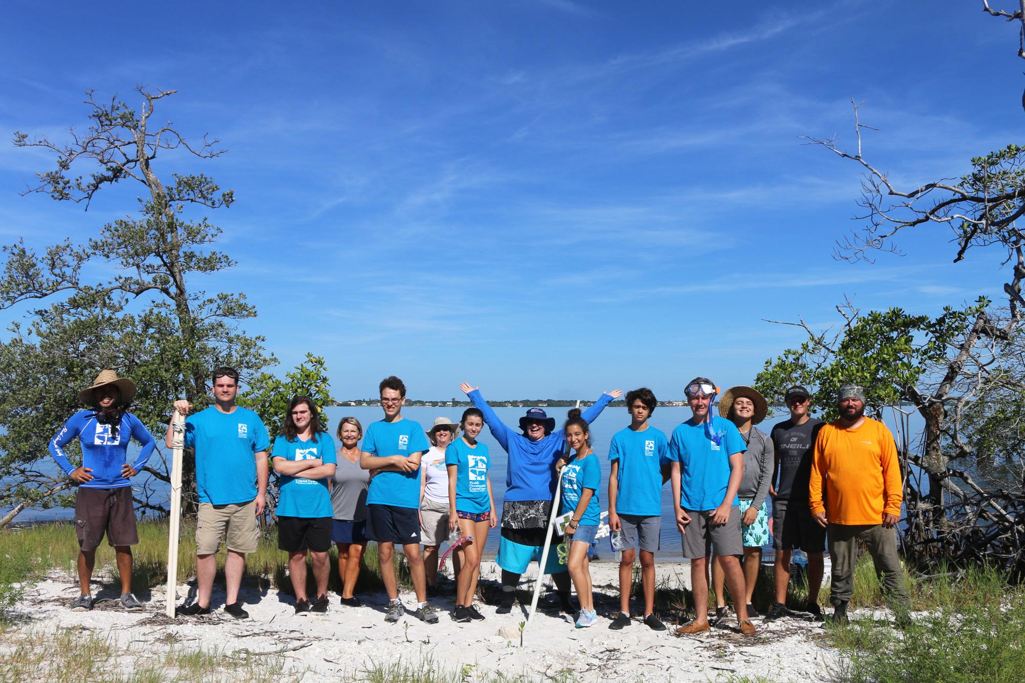 Teen volunteers standing in front of the lagoon
