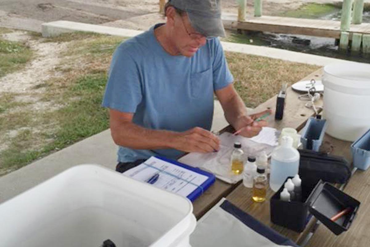 volunteer monitoring the water