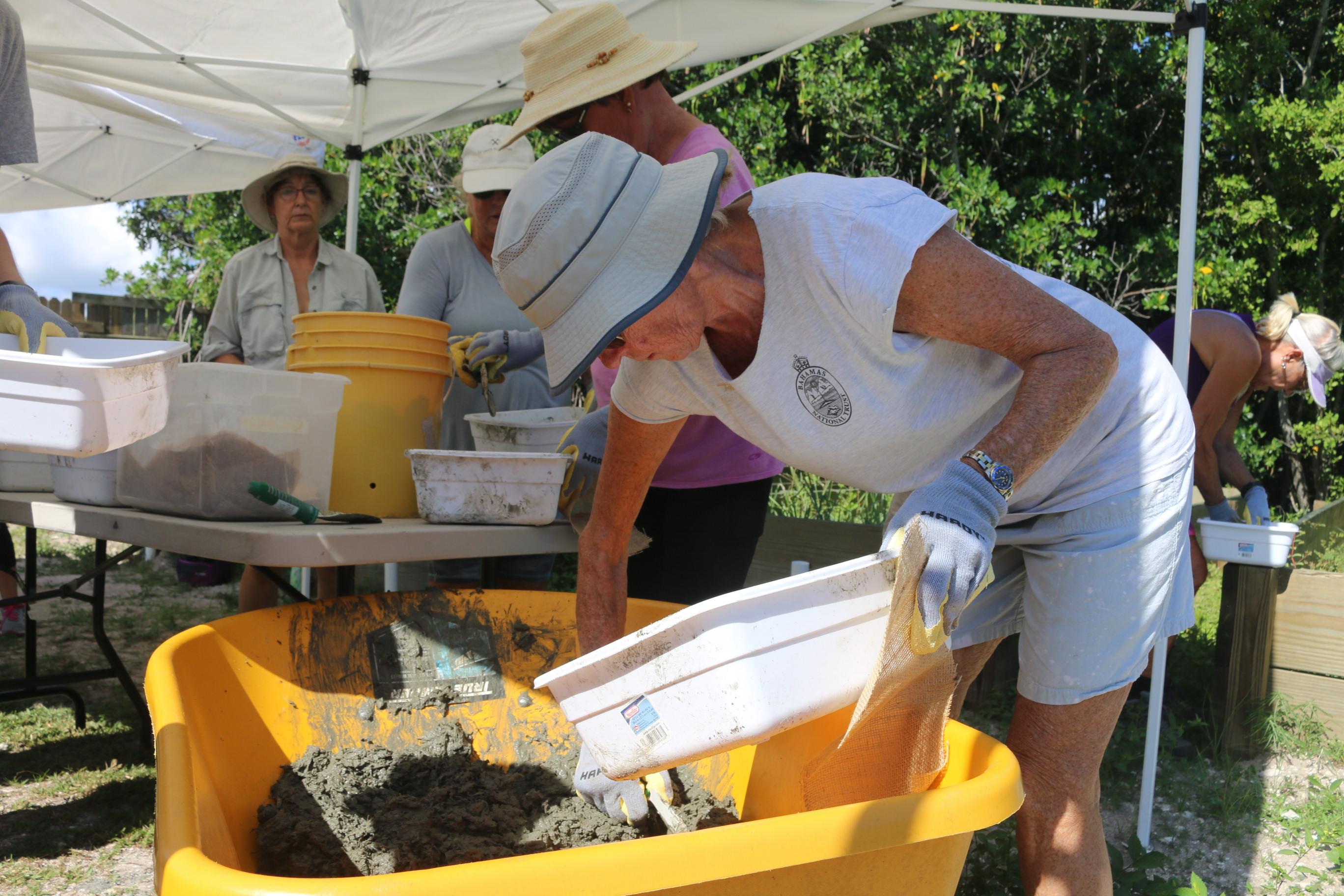 volunteers creating oyster reef restoration modules