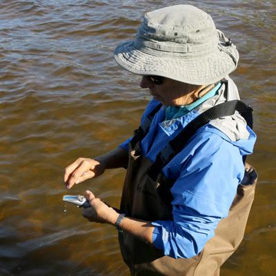Scientist monitoring the water